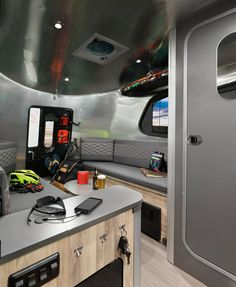 Take a peek inside the new 2017 Airstream Basecamp! Sleeps up to 2, with versatile bench seating that allows for entertaining space to seat 5, while providing ample storage and relaxation space. | Woodland Travel Center