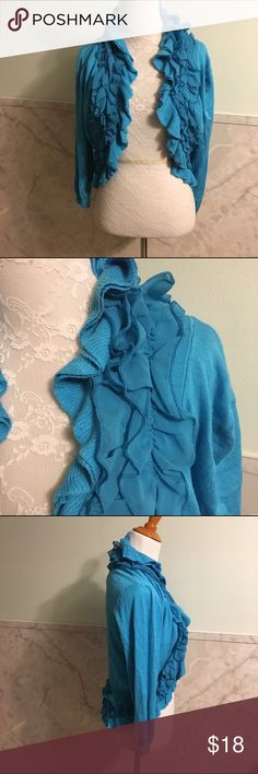 Soft Ruffled Blue Cardigan Large This cardigan has a really soft feel. It's made from viscose and nylon. The ruffles follow all the way around the rim of the sweater. They alternate with the normal material and a sheer ruffled material. This is a size large. P. Luca Milano Sweaters Cardigans