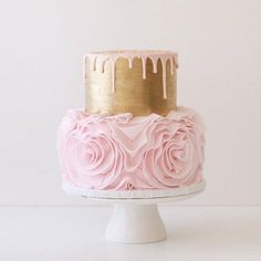 Pretty wedding cake with pink ruffle base and gold metallic top and drip finish