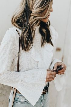 Pretty ruffled bell sleeved blouse in soft white.