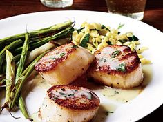 Seared Scallops and Herb Butter Sauce | Sear scallops in a cast-iron skillet and top with a savory pan sauce of butter, white wine and herbs. Serve with Roasted Green Beans and orzo for a dish that's perfect for dinner guests.