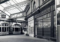 Booking hall, Hammersmith Underground station, Hammersmith & City line, showing shops and other commercial premises and part of pitched glazed roof. East End London, Old London, West London, London History, Fulham, London Underground, London Photos, Old City, Over The Years