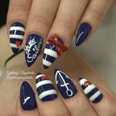 Red bow nautical nail art! Click to see a whole gallery of 3-D nail ideas.