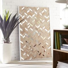 They say that fortune favors the bold, and we tend to agree. Just look at our modern wall panel. Handcrafted and hand-painted by Indonesian artisans, it boasts a bold chevron pattern of wooden zigs and mirrored zags. All of this and it doesn't cost a fortune.