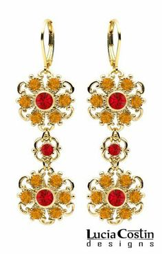 Victorian Style 24K Yellow Gold Plated over .925 Sterling Silver Flower Earrings by Lucia Costin with Red, Yellow Swarovski Crystals and Twisted Lines, Accented with 4 Petal Flowers and Dots Lucia Costin. $75.00. Update your everyday style with inspiration when wearing this piece of jewelry. Garnished with light siam and topaz Swarovski crystals. Splendid combination of dangle elements. Dangle earrings beautifully designed by Lucia Costin. Unique jewelry handmade...