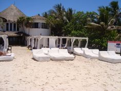 Sandos Caracol-- relax in a bali bed and enjoy your favorite beach drink!