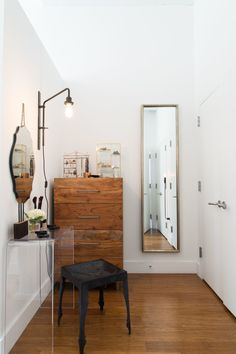 In the master bedroom, they did some minimal construction to add a partial-height wall, creating a changing area.