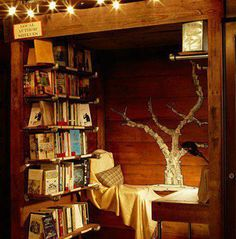 Lost in a Library: 11 Epic Reading Rooms >> reading nook w/ book page art <3