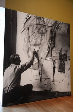 Dutch American abstract expressionist painter Willem de Kooning (1904-1997) in his studio. Photographer unknown.