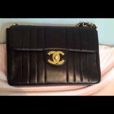 Vintage CHANEL Vertical Quilted Jumbo Flap Bag Authentic in Lambskin with huge 24kt gold plated hardware.  Made in France, 12 x 8 x 3.  Used, not abused. Shows scratches, a heavy scratch at base is not seen upon wearing. Includes care booklet /authenticity card. Sticker is intact. Lining is pristine. The bag has not lost the integrity of its shape, though it has been worn. The chain is very shiny with no plate loss showing. Small cloudy spot shows on CCs when lock is turned. ABSOLUTELY NO…