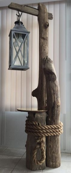 """Starting Woodworking Business Ohio River driftwood, converted lantern, brass table top, and massive rope all come together perfectly for this awesome """"nautical feel"""" floor lamp. Driftwood Flooring, Driftwood Art, Driftwood Table, Driftwood Furniture, Into The Woods, Wood Projects, Woodworking Projects, Woodworking Shop, Woodworking Equipment"""