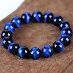 LINK IN OUR BIO 👉👉👉 Blue Tiger Eye is a very soothing stone as it aids in reducing stress, increasing calm and… Tiger Eye Jewelry, Tiger Eye Bracelet, Blue Tiger Eye Stone, Bracelets For Men, Beaded Bracelets, Blue Tigers Eye, Stone Bracelet, Stone Beads, Natural Gemstones