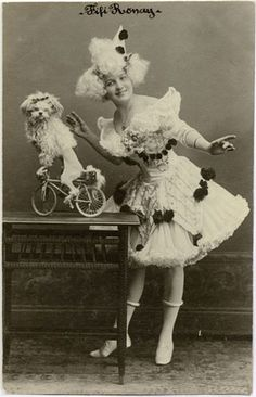 Fifi Ronay & Poodle on Bike.