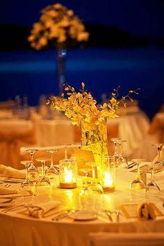A simple and romantic wedding centerpiece! {destinationweddings.com}