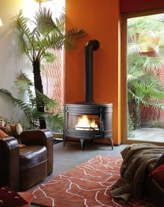 The Invicta Mandor is a cast iron woodburning stove with a unique oval shape and leg arrangement.