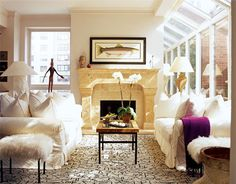 Comfortable seating and chic accessories create a relaxed elegance in this new sunroom addition.