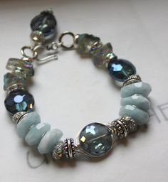 Make a statement with this chunky charm bracelet, with aquamarine bracelet and sterling silver, via Etsy. Wire Jewelry, Beaded Jewelry, Jewelry Bracelets, Blue Bracelets, Geek Jewelry, Gothic Jewelry, Jewelry Ideas, Jewlery, Bangles