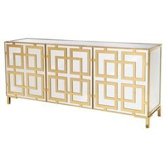 The Mercer Gold Regency Mirrored Brass Buffet is most certainly, a statement piece. With gorgeous Hollywood-style mirrored glass inlets and a geometric overplay of shiny brass, this piece is bold and eye catching. Adding storage, surface space and undeniable style, this buffet will transform your dining space. Ventilation holes in the back and covered grommets allow this piece to work as a glamorous media cabinet as well.