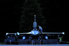 An Fighting Falcon pilot prepares for a night flight at Misawa AB, Japan, Sept. (Air Force photo by SSgt. Us Military Aircraft, Military Helicopter, Staff Sergeant, Aircraft Photos, Military Pictures, F 16, Us Air Force, Submarines, Armed Forces