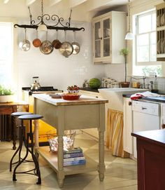 A custom-made cupboard and plate rack offer original storage strategies in this island.
