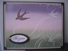 """By jackieohl at Splitcoaststampers.  Uses """"French Flair"""" stamp by Stampin' Up. Stamp in VersaMark & heat emboss with clear powder. Brayer ink in horizontal stripes onto background. Stamp larger bird again in purple. Add sentiment, mat, card base."""