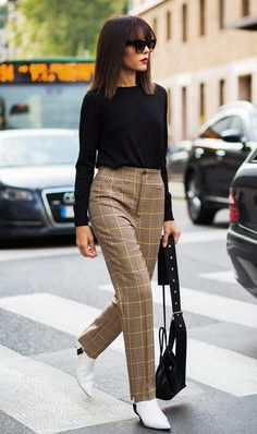Make a statement in plaid pants balanced out with a simple sweater.