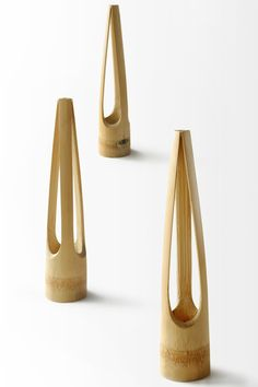 LENTUR vase resembles a delicate yet poetic masterpiece inspired by the gesture of one's three fingers holding a flower stem. A naturally bent curvature and a tapered triangular shape at. Bamboo Structure, Bamboo Crafts, Activities For Kids, Diy And Crafts, Hanger, Projects To Try, Delicate, Shapes, Woodworking Ideas