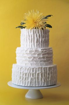 This all-white wedding cake gets visual interest from a unique texture and a bright yellow floral topper. White And Gold Wedding Cake, Yellow Wedding, Dream Wedding, Whimsical Wedding Cakes, Amazing Wedding Cakes, Country Garden Weddings, Mellow Yellow, Bright Yellow, Dessert