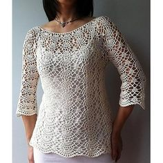 This semi-fitted top is worked from the neck down with gentle shaping below the waist for a figure skimming, flattering fit. Brimming with delicate lacy shells, this feminine piece is equally beautiful as a cropped top or tunic, with the sleeves three-quarter, slightly flared or short – the choice is yours. Skill Level: Advanced Intermediate Pattern includes both charts and written instructions. Note: This top with its open lace pattern allows for stretch as well as more fitted style. For…
