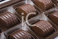 Royalty Free Photo of a Box of Chocolate Chocolate Box, Royalty Free Photos, Brown, Food, Meals, Chocolates, Yemek, Brown Colors, Eten