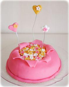 Cake decoration- i like the idea of iciiny opening to reveal something else