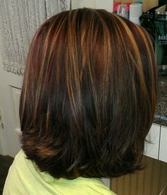 Red with Carmel highlights and med brown lowlights.