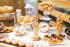 Donuts table desert of sweet santa fe ranch wedding that provide the guests with large options of delightful meals.