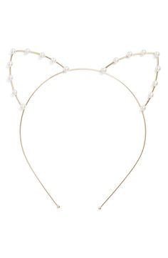 Lustrous pearly beads accent the adorably feline ears atop this darling metal headband.