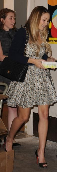 Who made Lauren Conrad's shoes, dress, bracelet, black purse and necklace that she wore at a book signing in Miami, February 10, 2010?