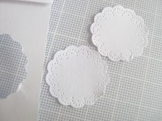 Make your own miniature doilies DIY - a lot of work but could have different colors and types of paper this way - includes printable pattern