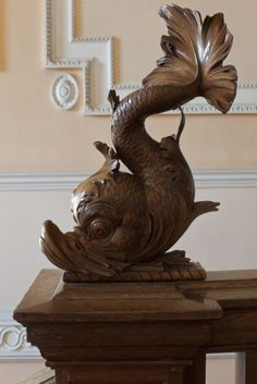 Carved wooden fish finial on the Oak Staircase at Clandon Park, Surrey.