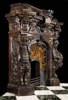 Antique Spanish Mannerist fireplace mantel in carved wood.
