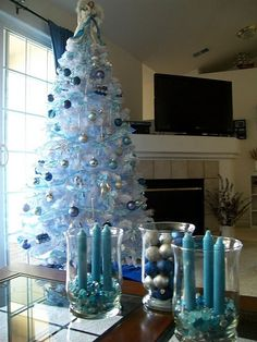 Silver and Blue holiday tree! Very cool for the holidays! Blue Christmas, Christmas Themes, Christmas Tree Decorations, Christmas Holidays, Turquoise Christmas, Coastal Christmas Decor, Christmas Mantels, Beautiful Christmas Trees, Magical Christmas
