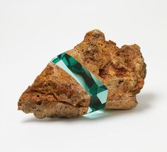 This is an example of contradictory texture sculpture. This is because the rock is sandwiched with the gem that provides contradictory texture.