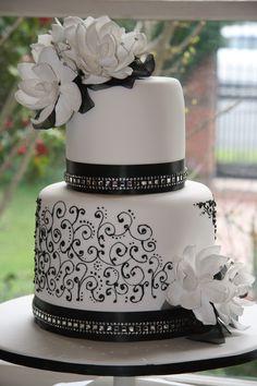 Black & white wedding cake with scrollwork design.