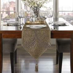 Sadira Table Runner in Graphite The stunning Sadira Table Runner features a lustrous, medallion design woven in a luxurious chenille fabric. The table runner's deep, sterling grey color with gold accents adds a stylish complement to your table setting.