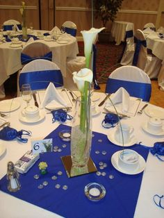 Calla lily centrepiece with matching calla lily table numbers and holders.