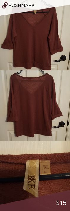 Women's burgundy shear sweater The title maybe be confusing, I'm sorry but that is the best way to say it. It's wearable like a sweater if you put a tank top or any under garment of your choice under it.  It's a beautiful burgundy color, good for winter seasons. BKE Sweaters V-Necks