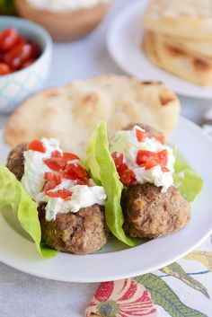 Falafel meatballs! Wrapped up in lettuce (or naan!) and smothered in tzatziki sauce. Yum!