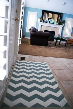 A painted chevron patterned rug. Who knew you could paint a rug?!