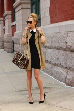 simple black dress under a beige trench w/ black pumps and a splash of print in her bag.