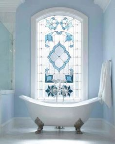 Bathroom window... So pretty!!!   This would be a great color to redo my present bathroom.  With the ugly green stained glass.