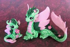 Flower dragons! I just love how they turned out. It's kind of fun concepting these out on paper and then sculpting them. Here is her concept art by the way: dragonsandbeasties.deviantart.… S...