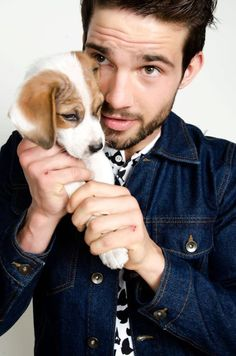 Men with beards holding dogs (two kinds of adorable in the same picture!)